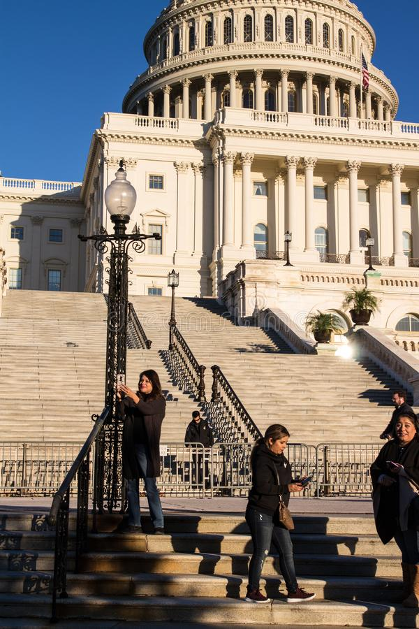 Woman Taking Selfie on Steps of United States Capitol Building stock images