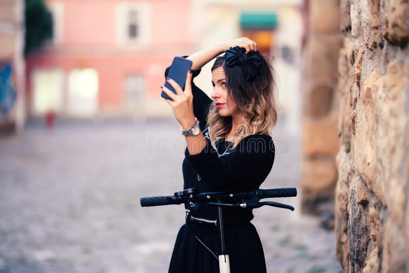 woman taking selfies with phone camera. Portrait of cheerful girl smiling and taking photographs stock photos