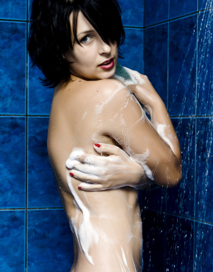 Woman Taking A Shower Royalty Free Stock Images