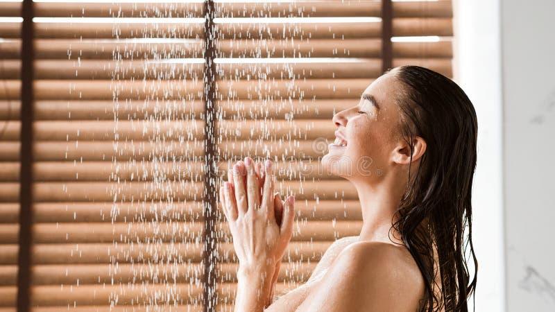 Woman Taking Shower Enjoying Water Splashing On Her royalty free stock image