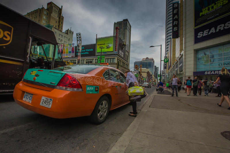 A woman taking a taxi royalty free stock photo