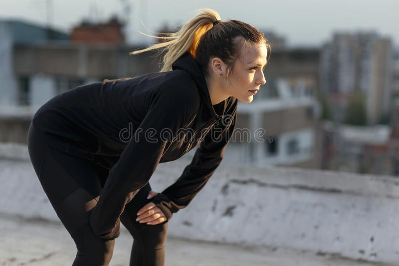 Woman taking a workout break royalty free stock images