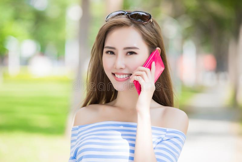 Woman talk on phone. In the park stock photos