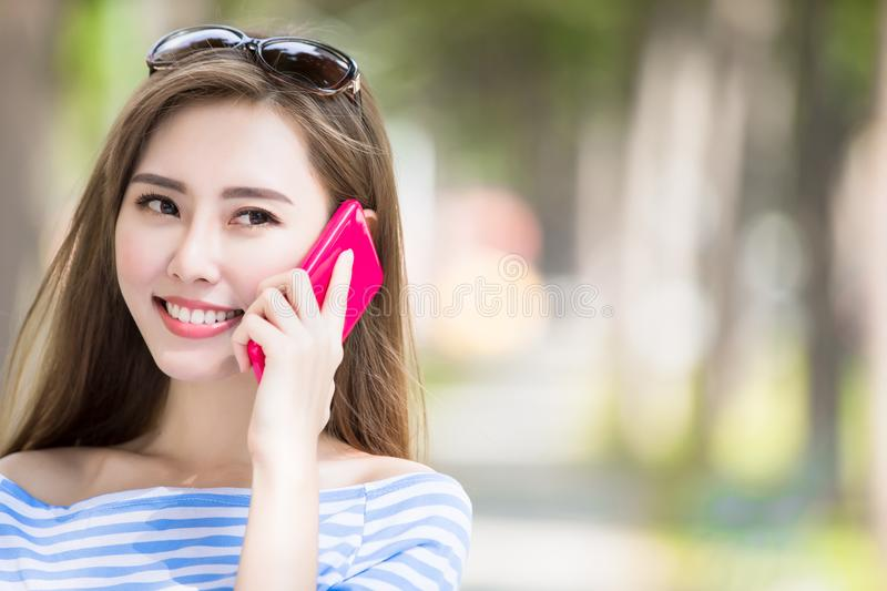 Woman talk on phone. In the park stock images