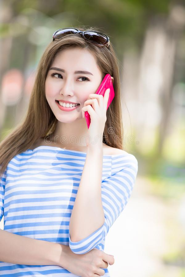 Woman talk on phone. In the park royalty free stock images