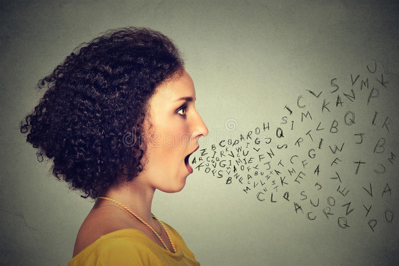 Woman talking with alphabet letters coming out of her mouth. Communication intelligence concept royalty free stock images