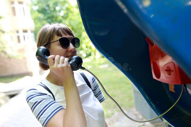 Woman talking on analog phone stock photo