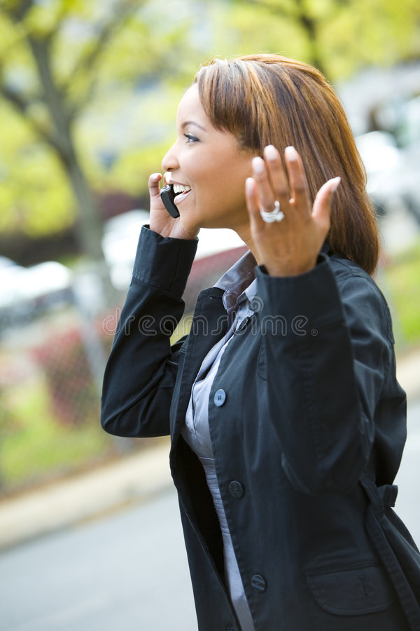Woman talking on a cell phone stock photos