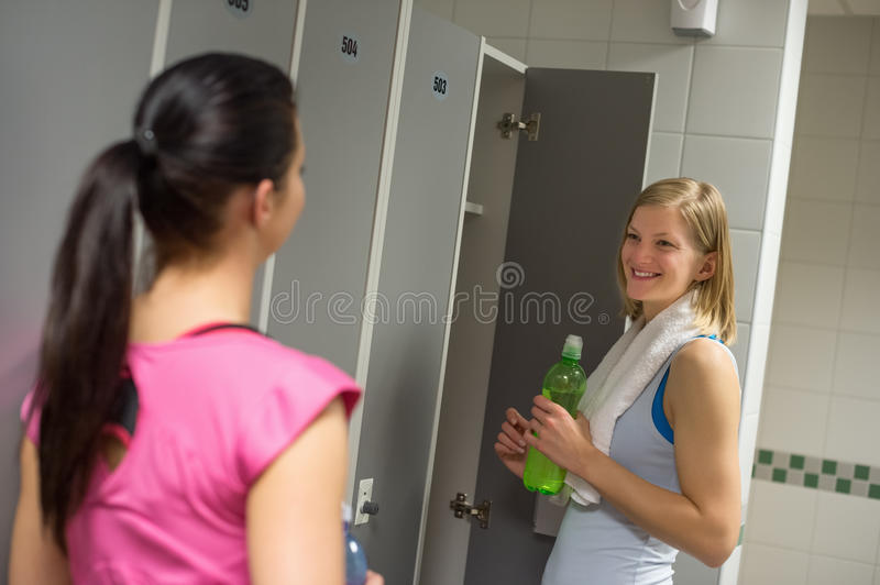 Woman talking with friend in changing room stock photo