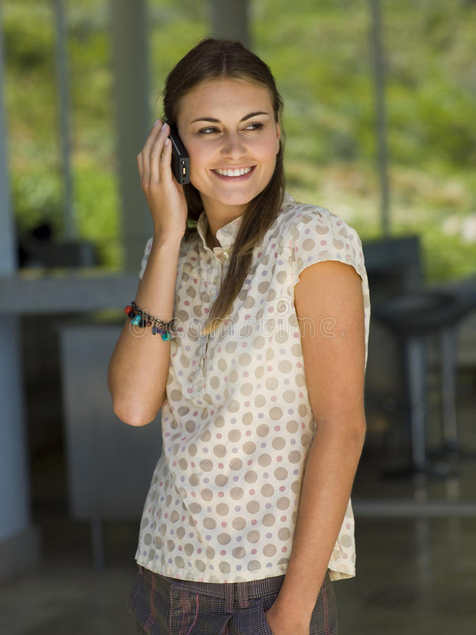 A woman talking on her cell phone. stock images
