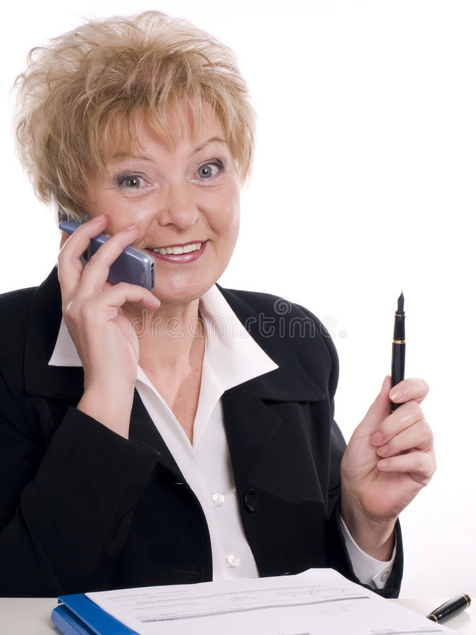 Woman talking by mobile phone royalty free stock photography