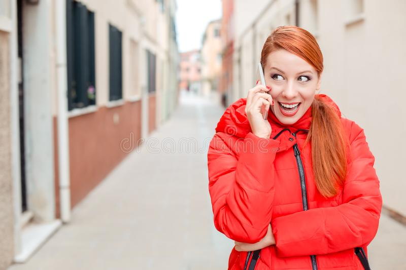 Woman talking at mobile phone European street on background royalty free stock photo