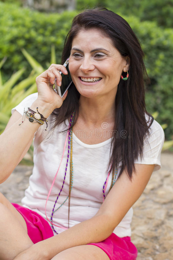 Woman talking on the mobile phone royalty free stock photo