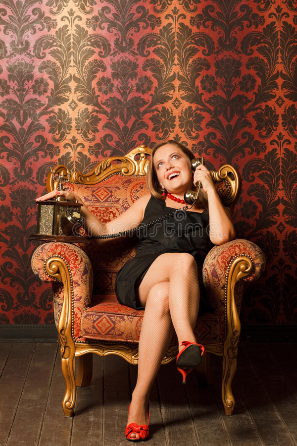Free Woman Talking On The Old Phone. Royalty Free Stock Images - 15690629