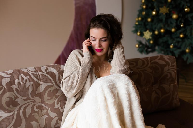 Woman talking over the cell phone royalty free stock photography