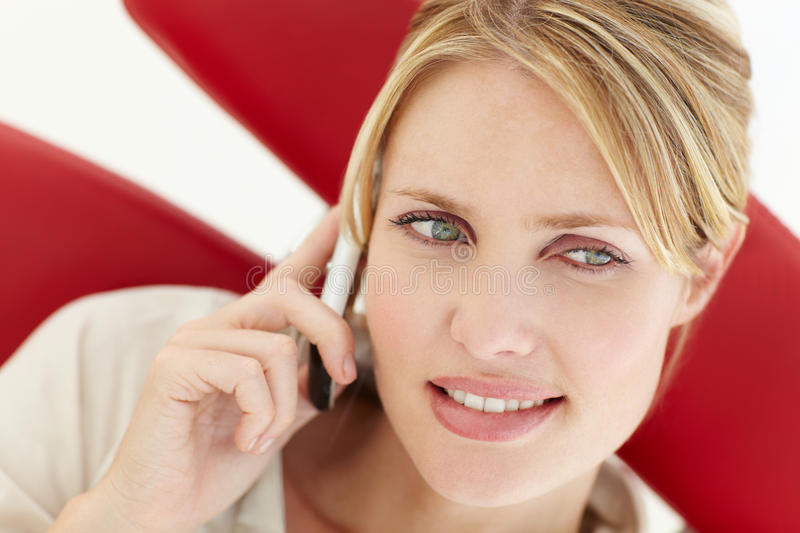 Woman talking on the phone. Looking off camera royalty free stock photography