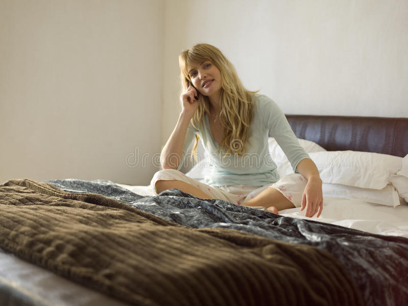 A woman talking on the phone. stock photos