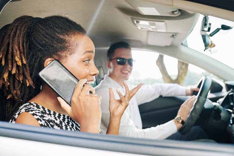 Woman talking on the phone during driving stock photos