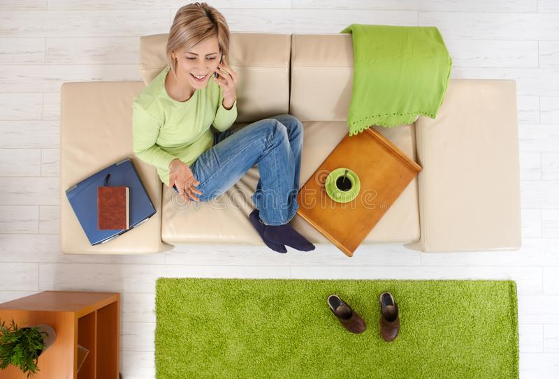 Download Woman Talking On Phone On Sofa Stock Photo - Image: 41198376
