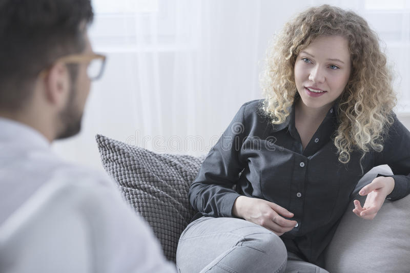 Woman talking with psychiatrist. About her getting better stock photo