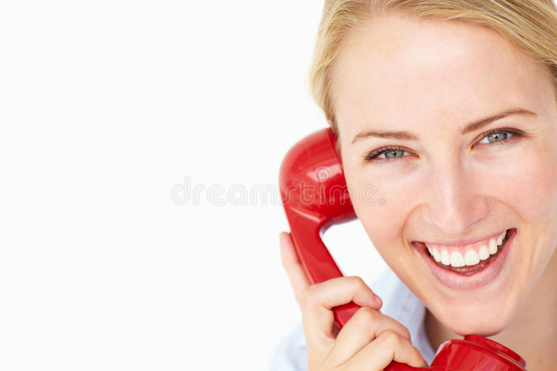 Woman talking on telephone stock photography