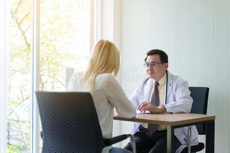 Woman talking to doctor psychiatrist in hospital,Discuss issue and find solutions to mental health problems. Women talking to doctor psychiatrist in hospital royalty free stock photography