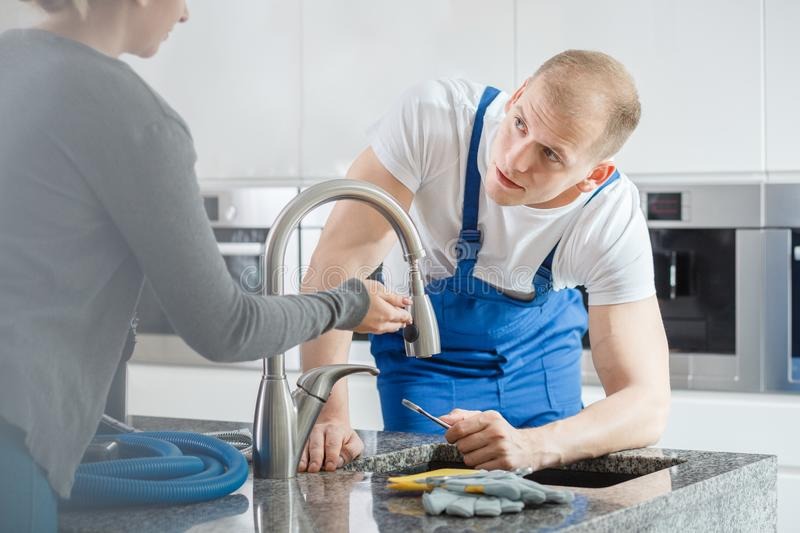 Woman talking to plumber royalty free stock images
