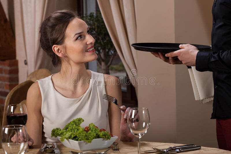 Woman talking with waiter royalty free stock photos