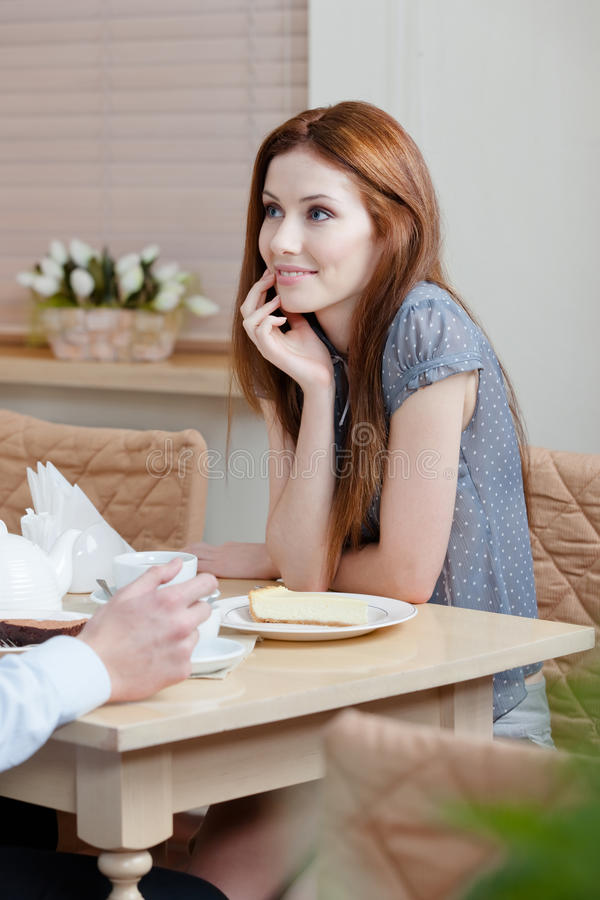 Woman talks with man at the shop stock image
