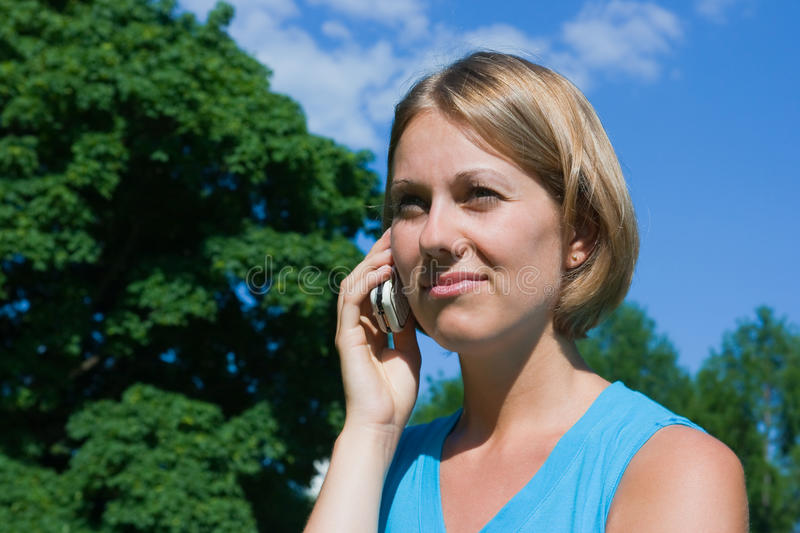 Download The Woman Talks By A Mobile Phone Stock Photo - Image of dialogue, calls: 9712144