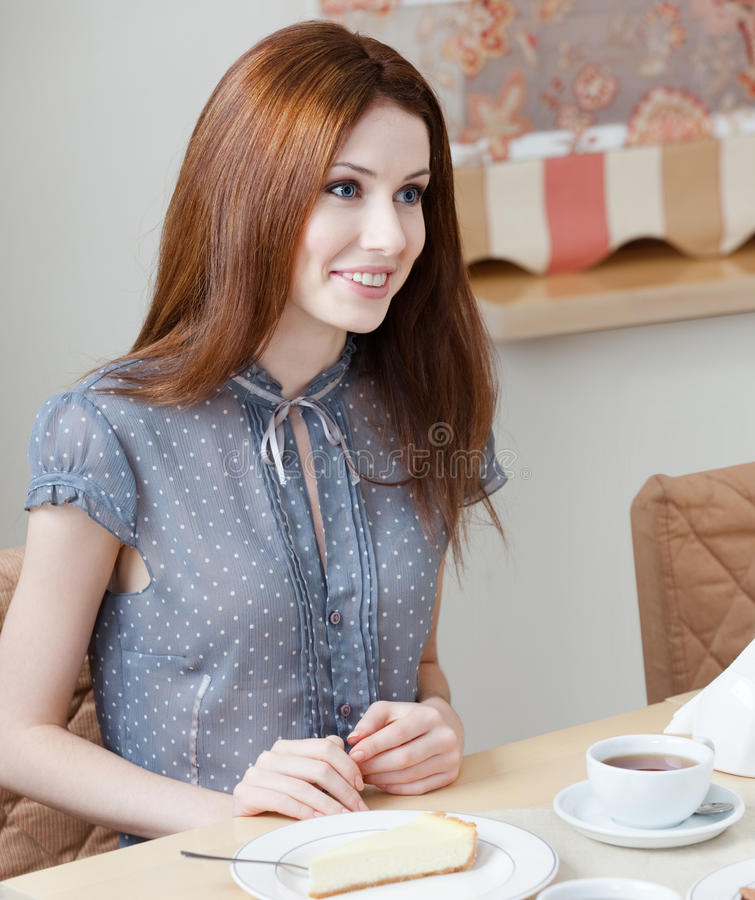 Woman talks with someone at the coffee house royalty free stock photography