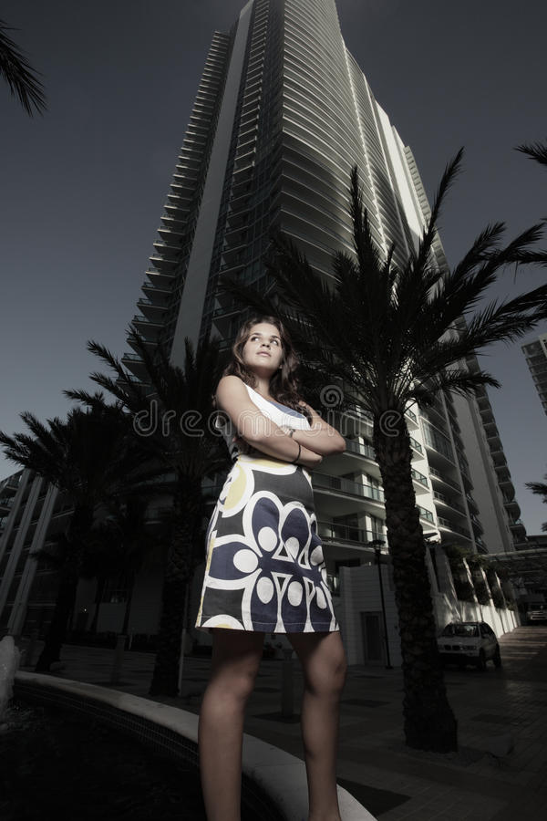 Woman with a tall builgind. Woman and a tall sky scraper in the background stock images
