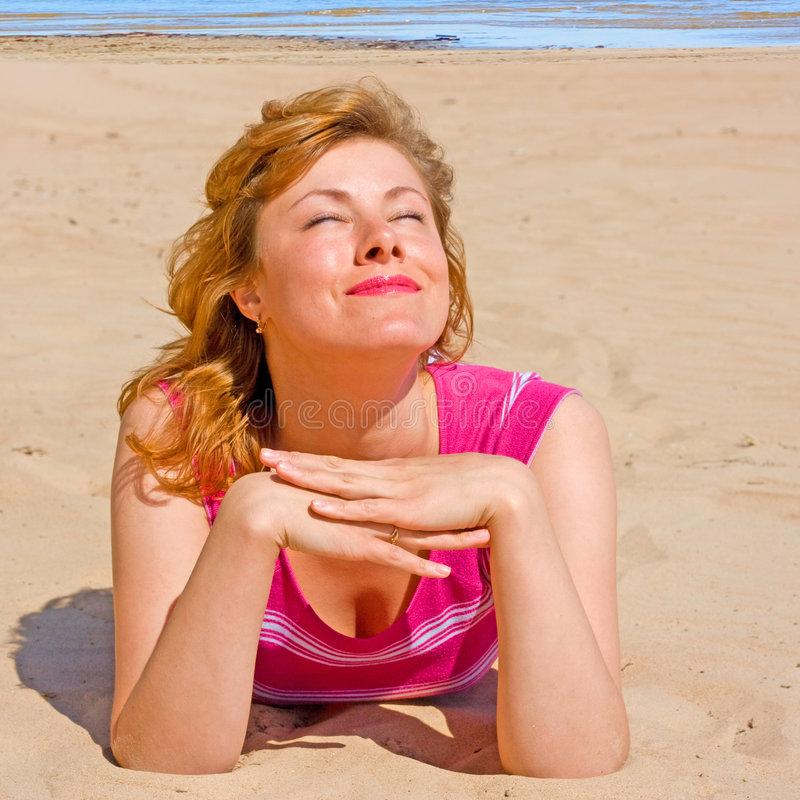 Woman tanning royalty free stock photography