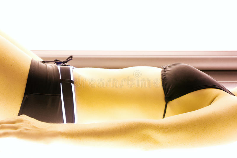 Woman Tanning In Solarium Royalty Free Stock Photos
