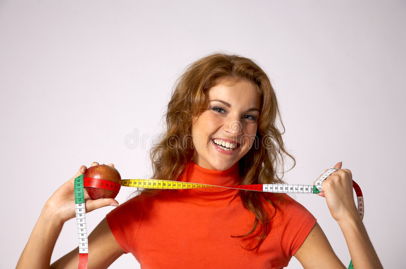 Woman with tape and apple stock photography