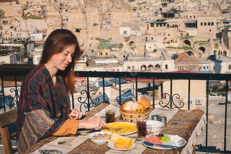 Woman taste traditional turkish breakfast in Cappadocia royalty free stock photo