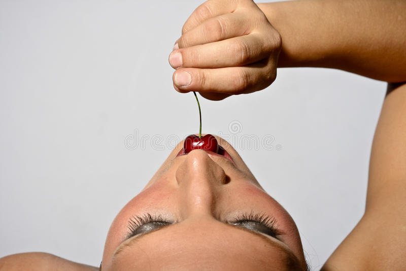 Woman Tasting A Cherry