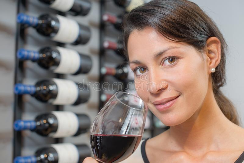 Woman tasting some wine royalty free stock photography