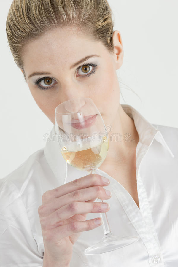 Woman tasting white wine royalty free stock photography