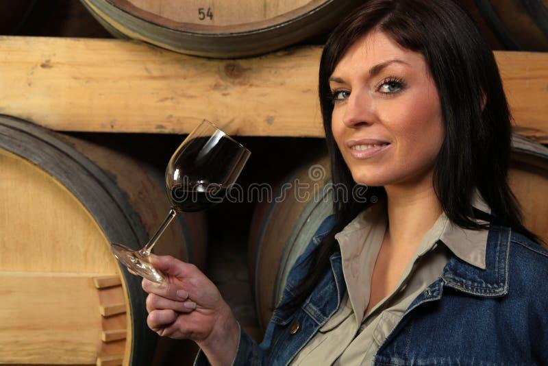 Woman tasting wine royalty free stock photo