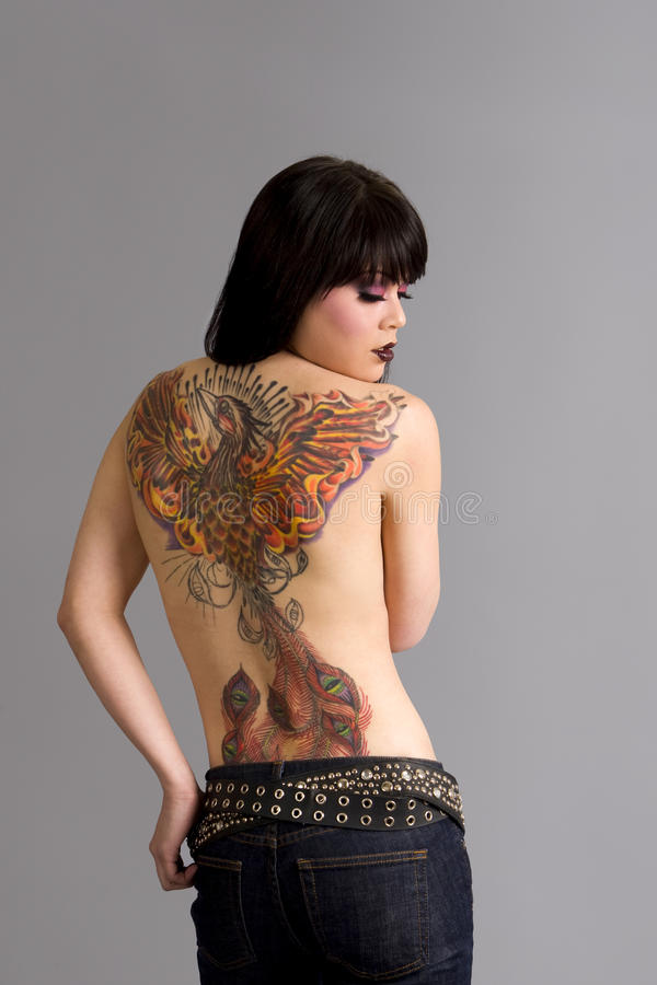 Woman with tattoo. Beautiful exotic woman with colorful tattoo