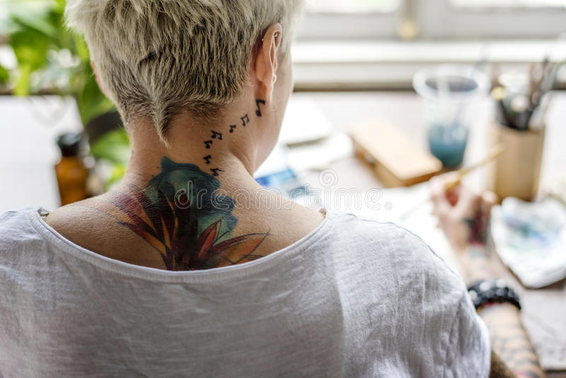 Woman with Tattoo Painting Water Color Art Work Hobby Leisure Re. Ar View royalty free stock photo