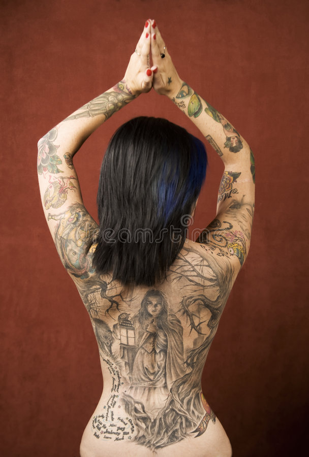 Woman with tattoos royalty free stock images