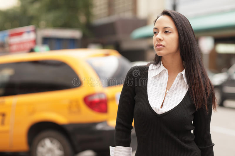Woman and a taxi cab stock images