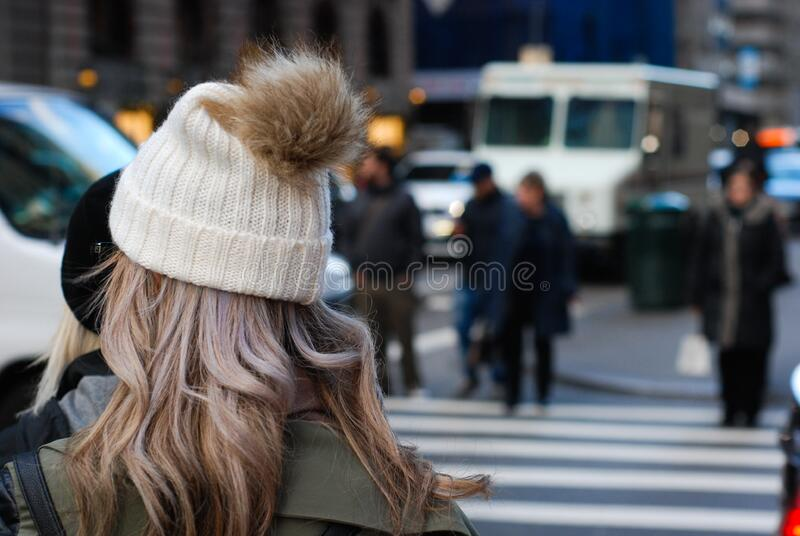 Woman in tea cozy hat chatting stock images