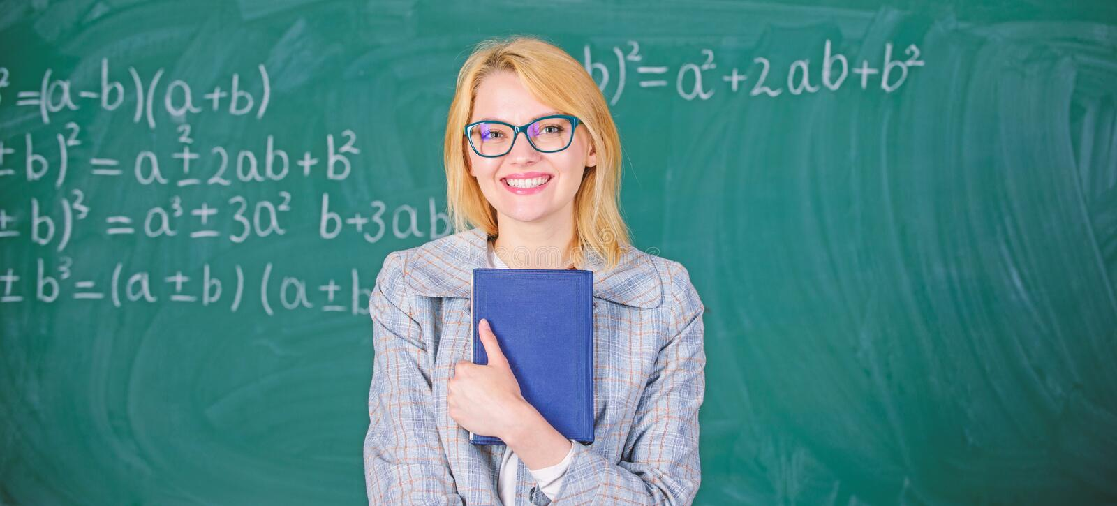 Woman teacher with book in front of chalkboard think about work. Cognition process in learning. Cognition process of stock photography