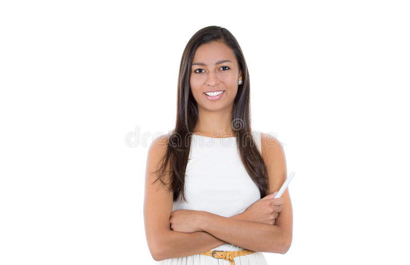 Woman teacher or business woman or a confident happy smiling student holding chalk standing in white dress stock photo