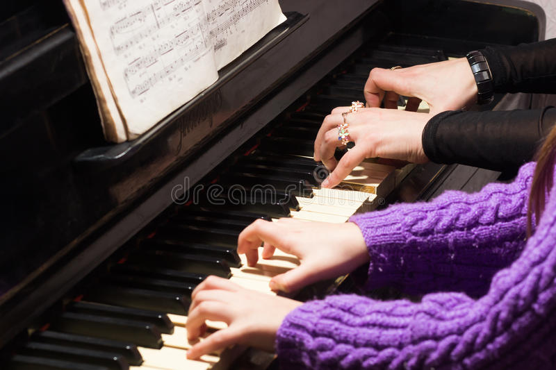 Woman teaching girl to play the piano. royalty free stock photo