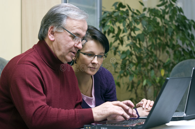 Download Woman Teaching Senior Use Of Computers Royalty Free Stock Photos - Image: 8317508