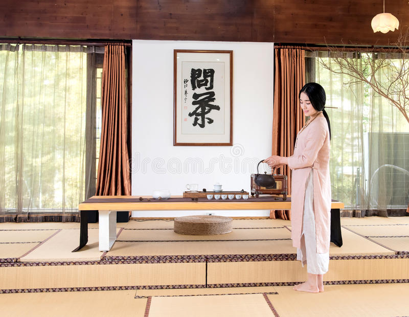 A woman with a teapot-China tea ceremony royalty free stock photography